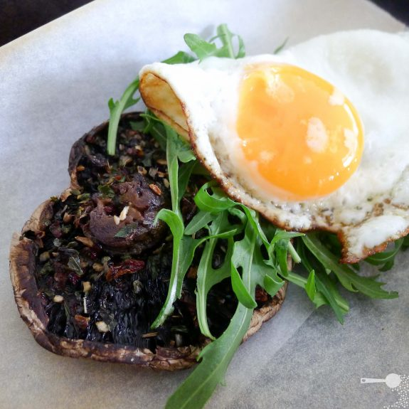 Grilled field mushroom with feta, egg and rocket